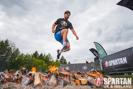 man jumping over fire at Spartan Race UK