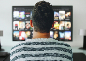 Man watching AVOD services