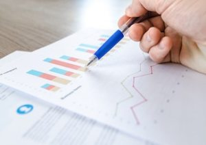 marketer analysing financial charts